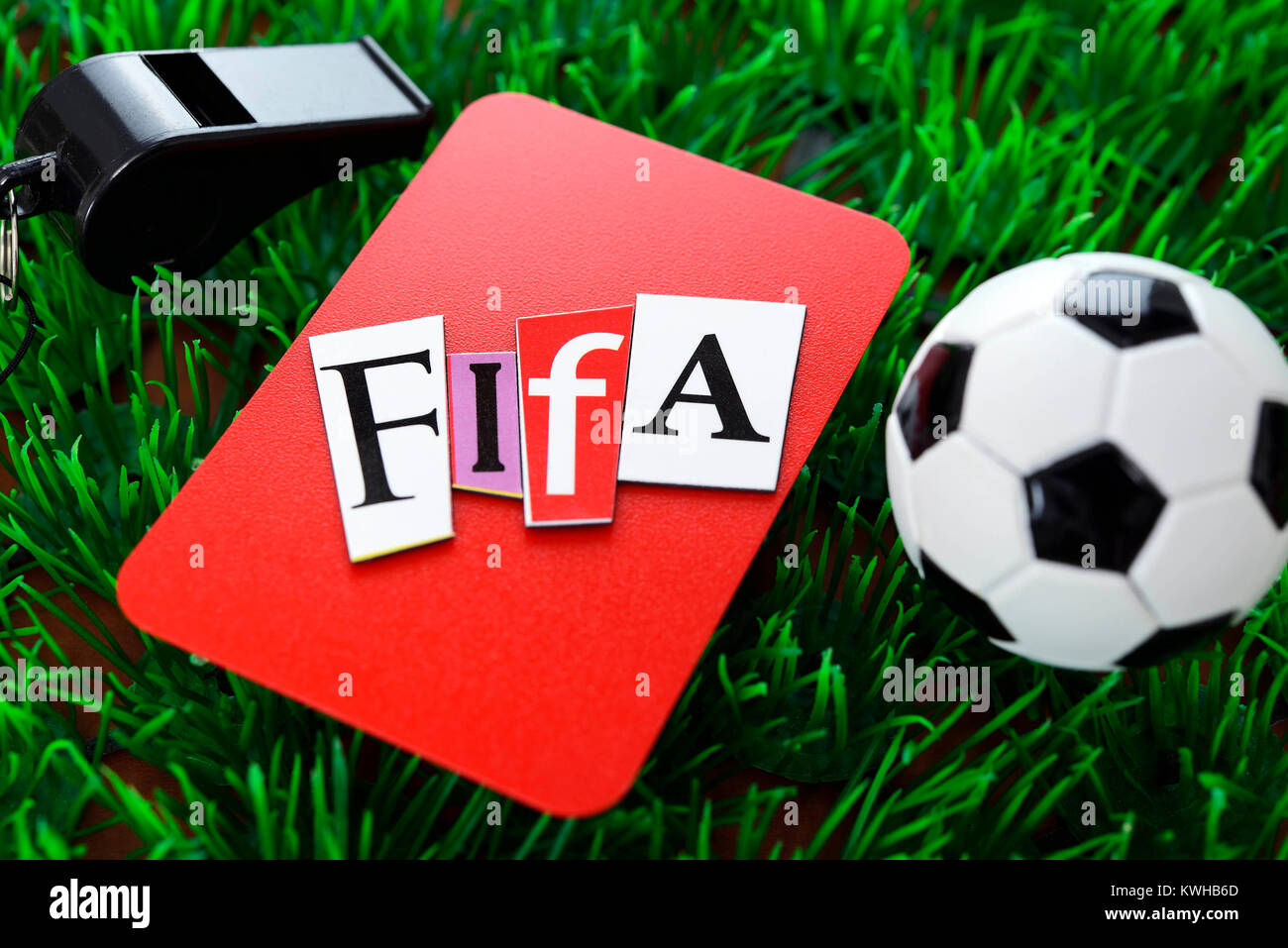 Miniature football and red map, Fifa scandal, Miniaturfußball und rote Karte, Fifa-Skandal - Stock Image