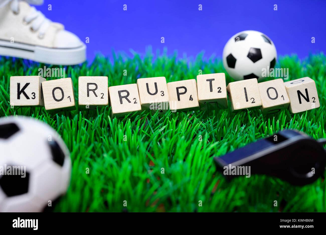 Stroke corruption from cube letter and miniature soccer balls, Fifa scandal, Schriftzug Korruption aus Würfelbuchstaben - Stock Image