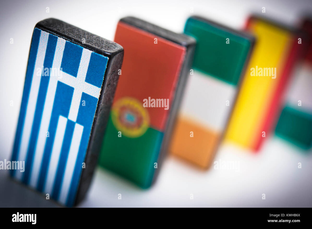 Dominos with European flags, symbolic photo domino effect to Grexit, Dominosteine mit europäischen Fahnen, Symbolfoto Stock Photo