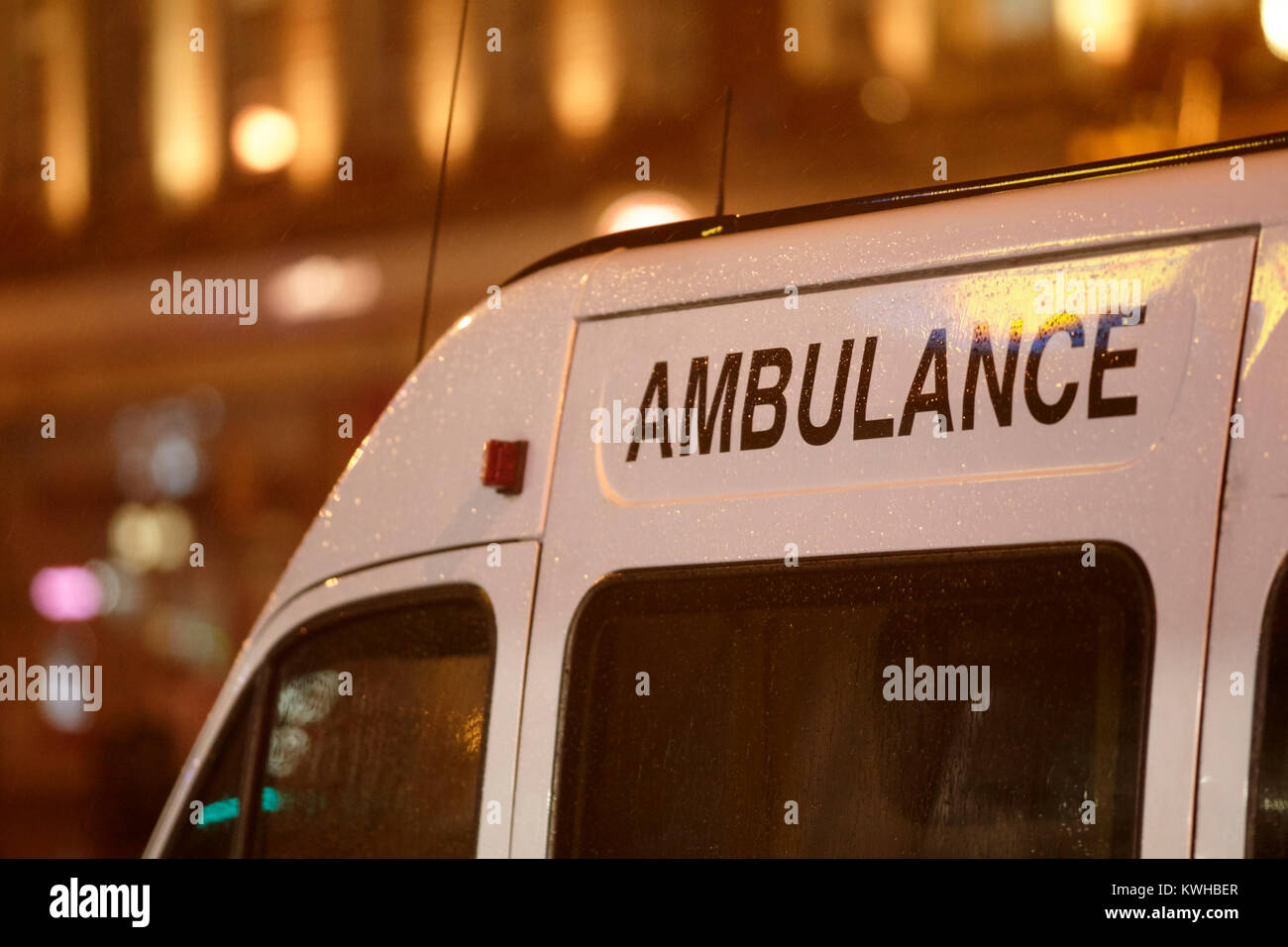 private ambulance waiting in city centre in the rain belfast northern ireland uk Stock Photo