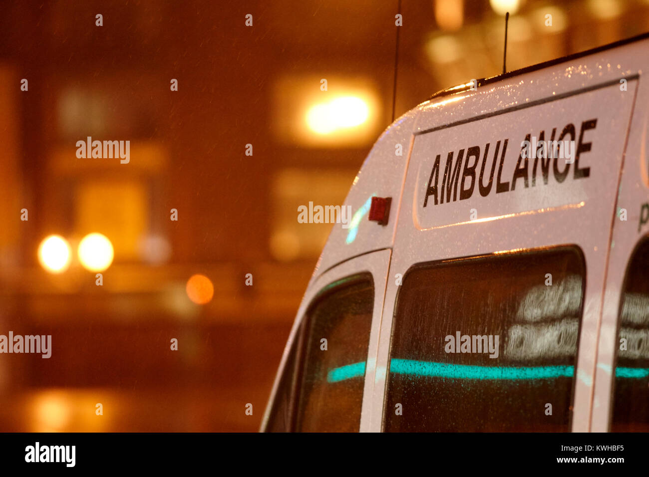 private ambulance waiting in city centre in the rain belfast northern ireland uk - Stock Image