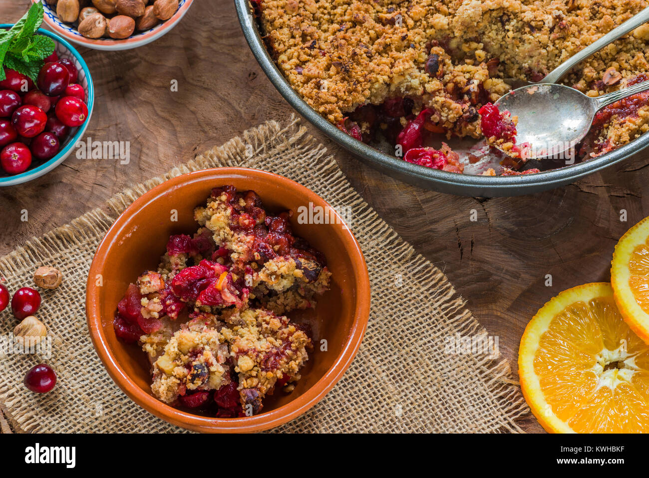 Cranberry, apple  and hazelnut crumble - top view Stock Photo