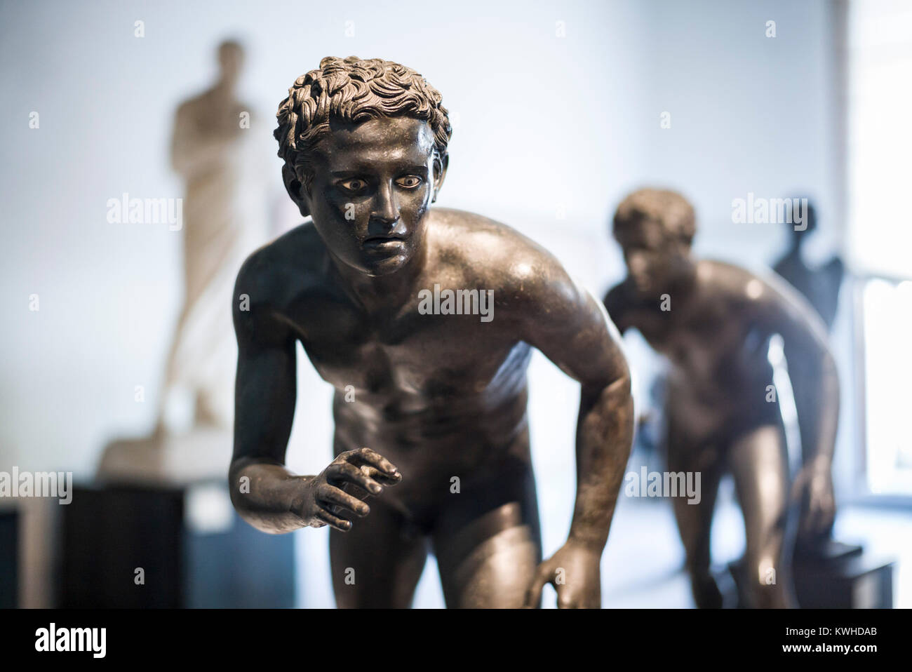 Naples. Italy. Bronze statue of an athlete (probably a runner) from the Villa dei Papiri in Herculaneum. Museo Archeologico - Stock Image