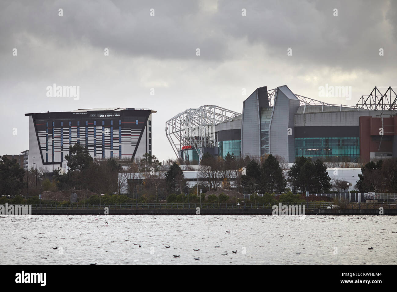 Hotel Football and Old Trafford stadium, home of Manchester United Football Club seen across the Ship Canal in Salford - Stock Image