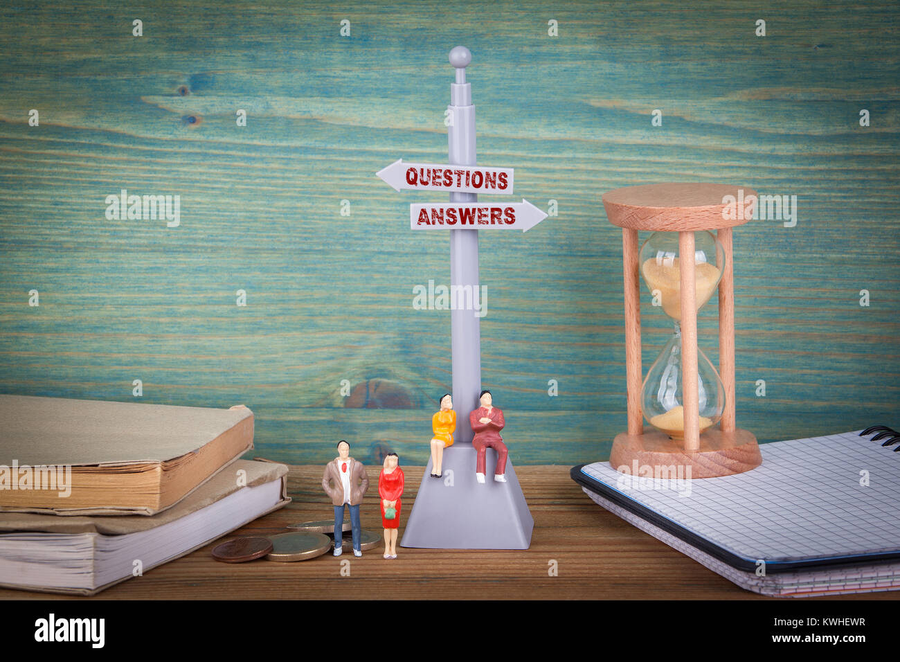 questions and answers. Signpost on wooden table. - Stock Image