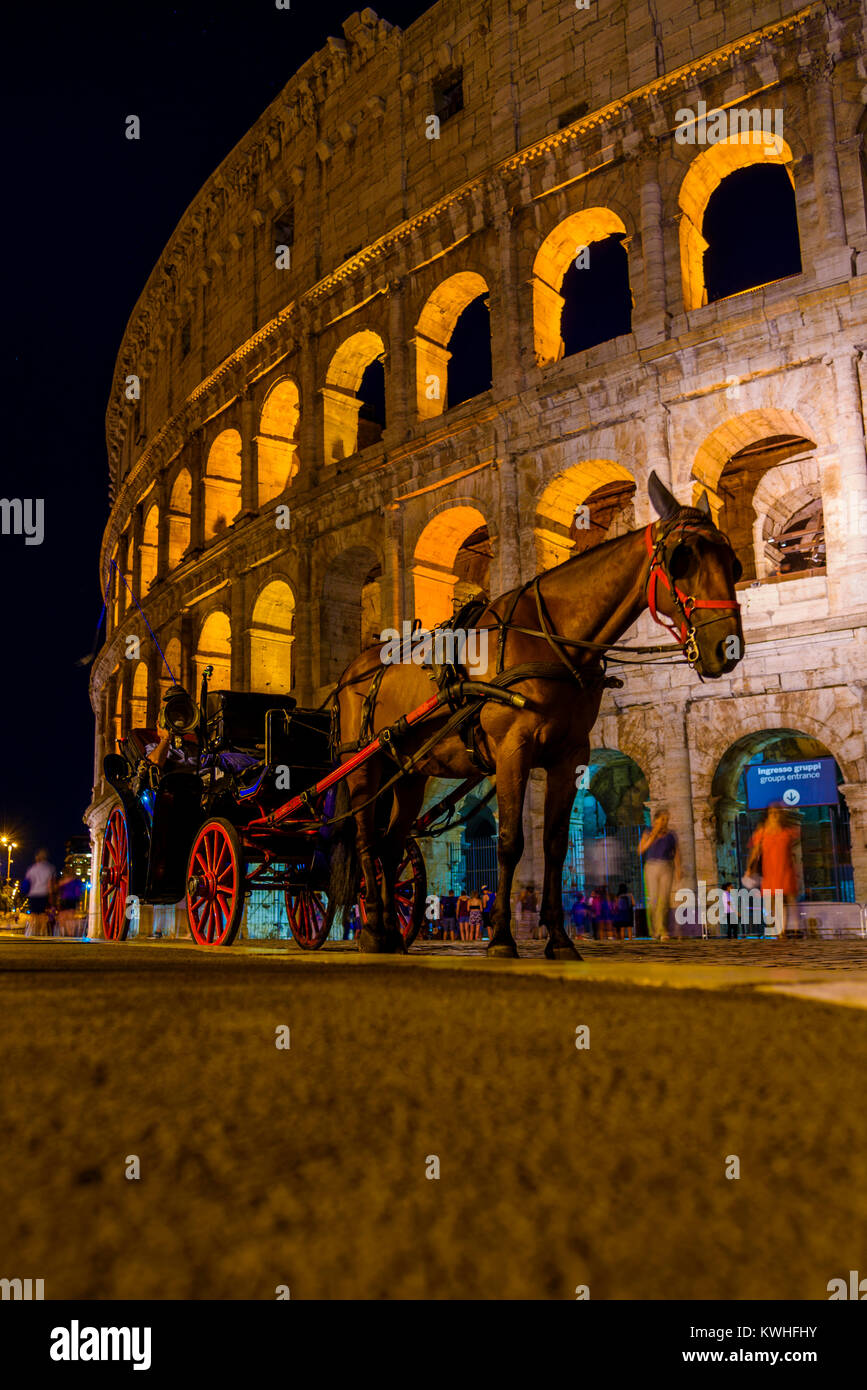 Horse Carriage at The Colosseum by Night Rome, Lazio, Italy Stock Photo