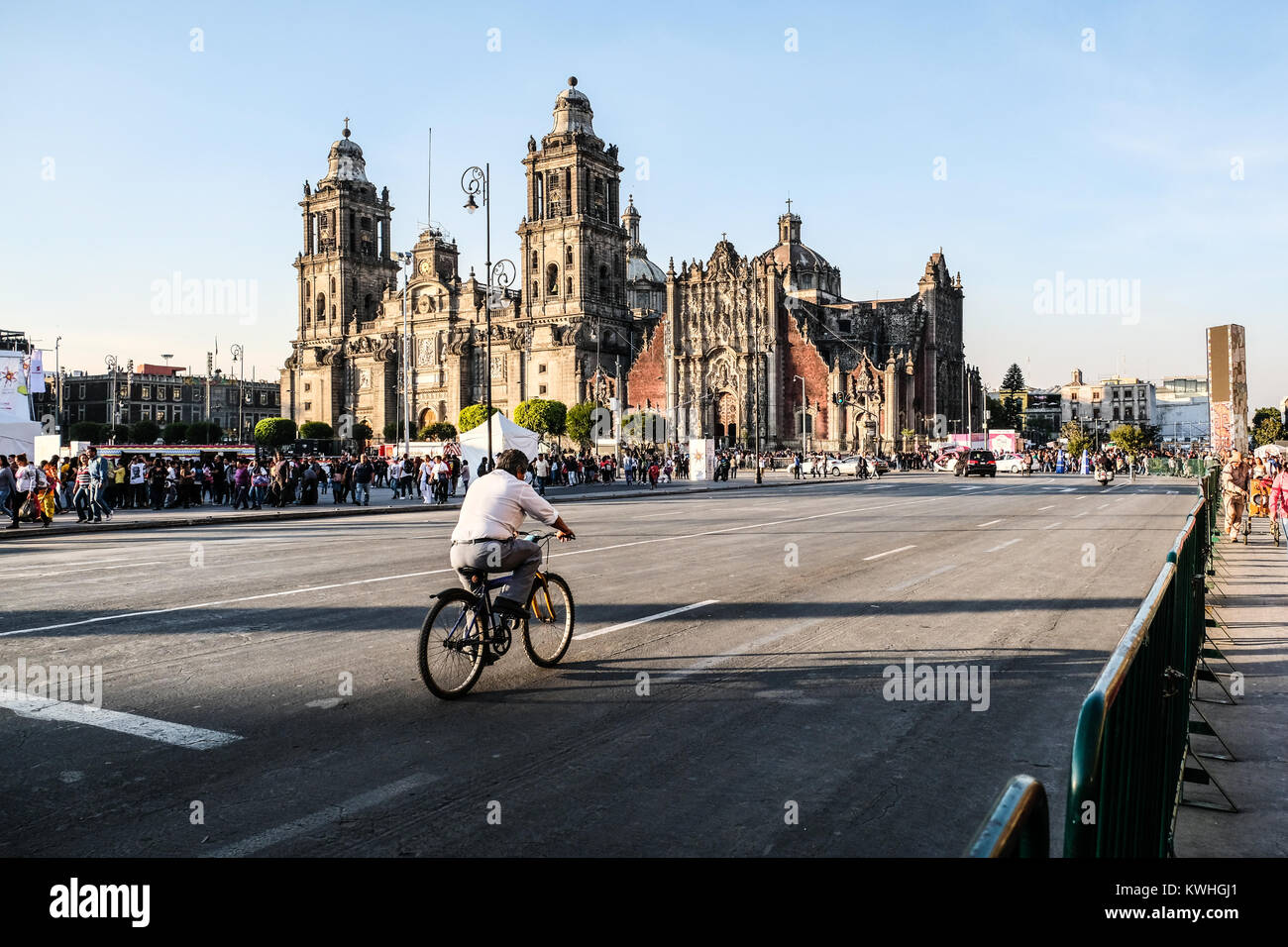 A lone cyclist riding on empty street by Zocalo square Mexico City - Stock Image