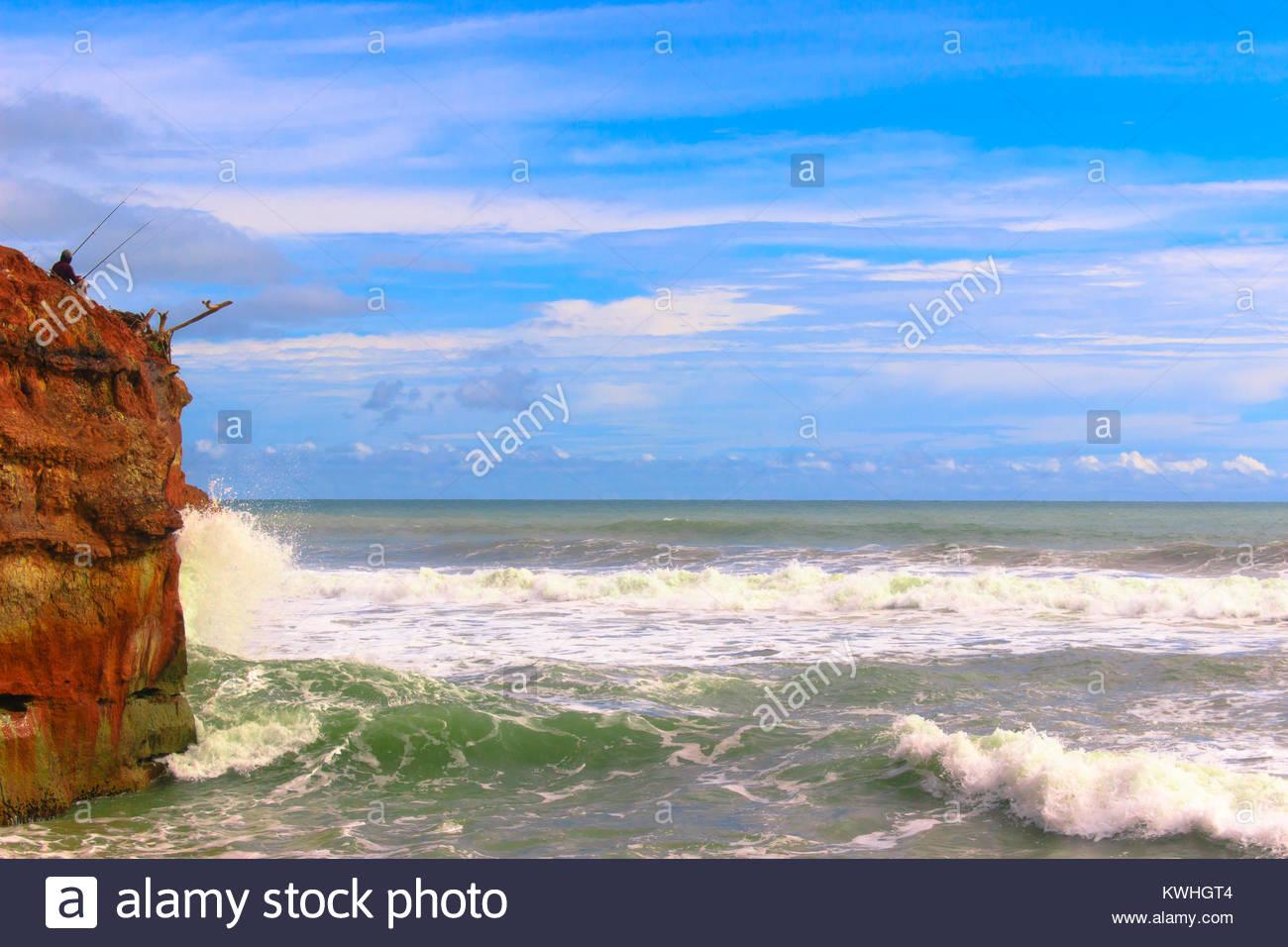 fishing among danger line - Stock Image