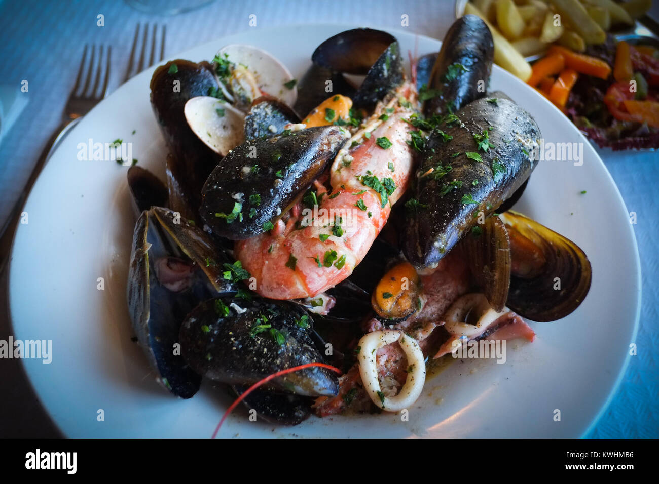 Fresh seafood stew at a restaurant in Mgarr, Gozo, Malta - Stock Image