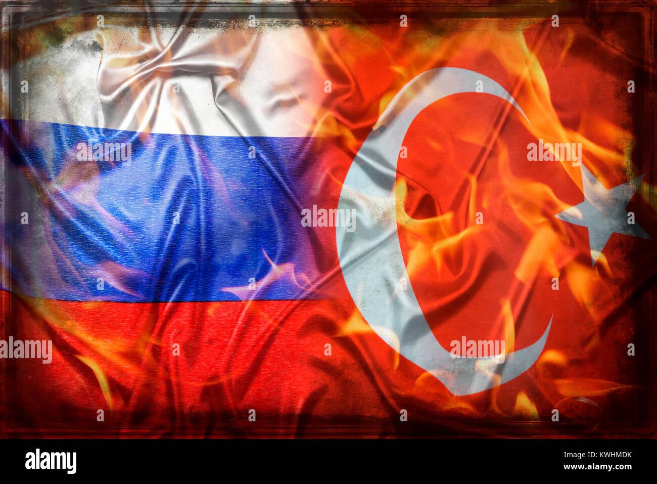 Flags of Turkey and Russia with flames, crisis between Russia and Turkey, Fahnen von Tuerkei und Russland mit Flammen, - Stock Image