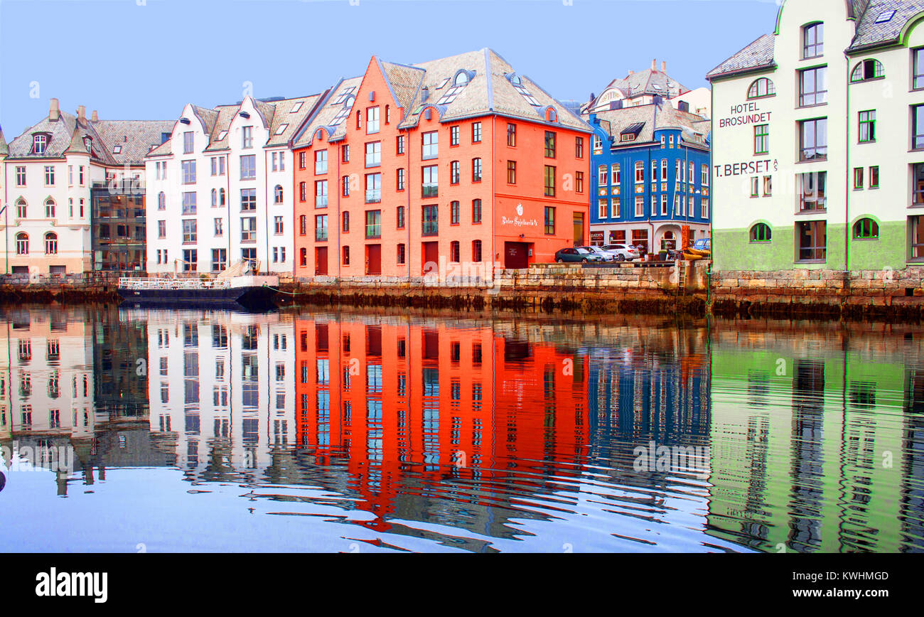 Alesund waterfront, Norway, with it's colourful buildings and bright reflections in the water - Stock Image