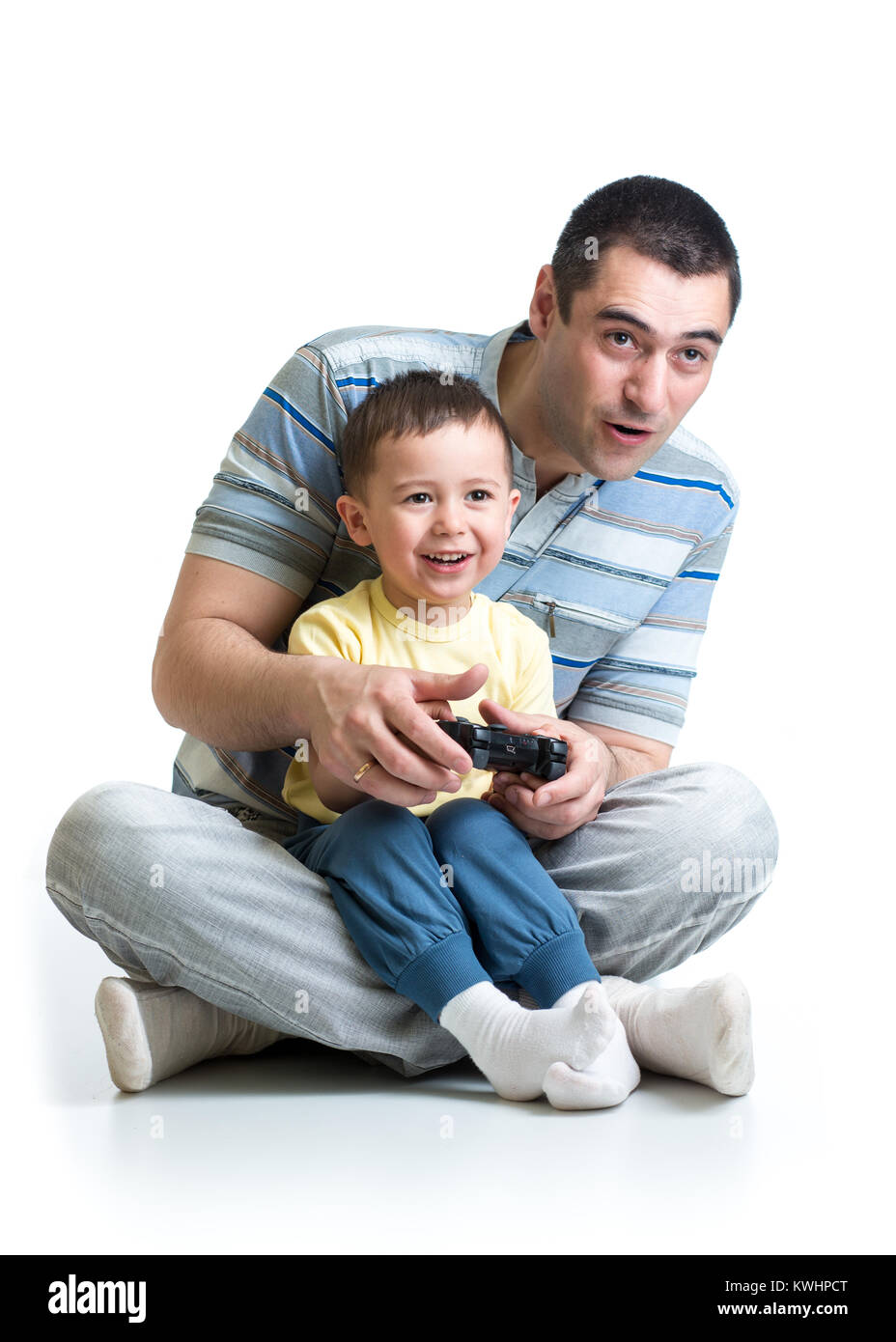 child boy and father play with a playstation together - Stock Image