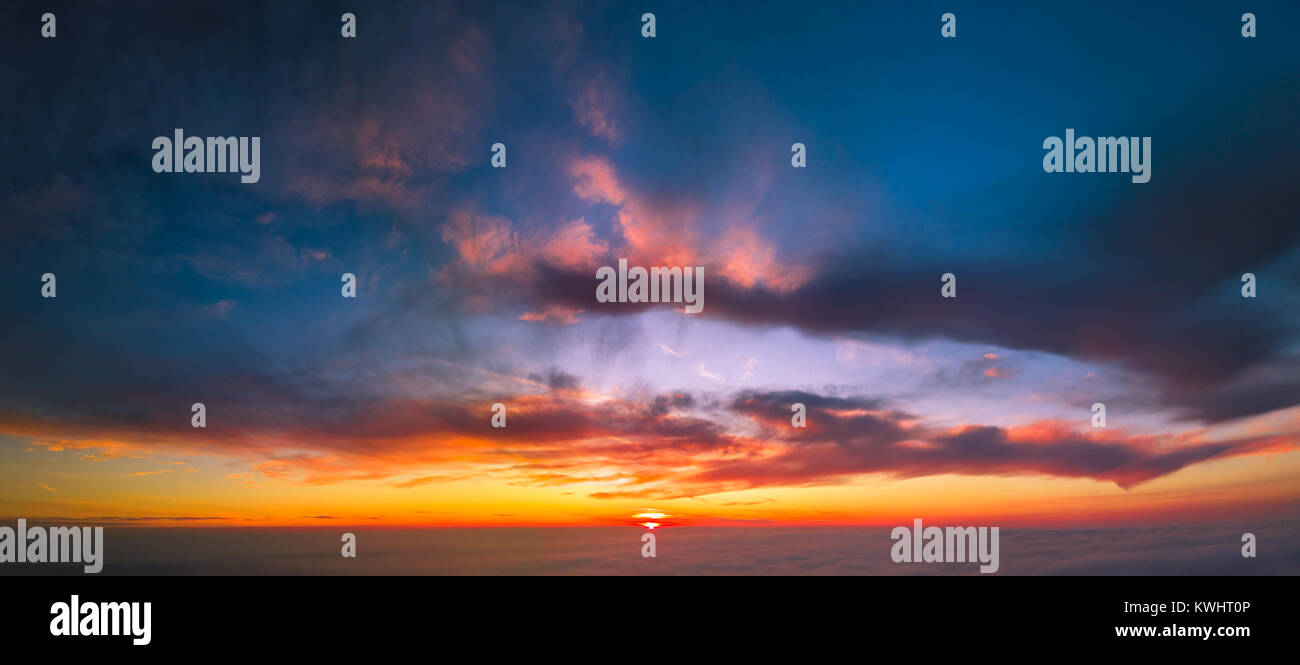 Flying between the cloud at sunset - Stock Image