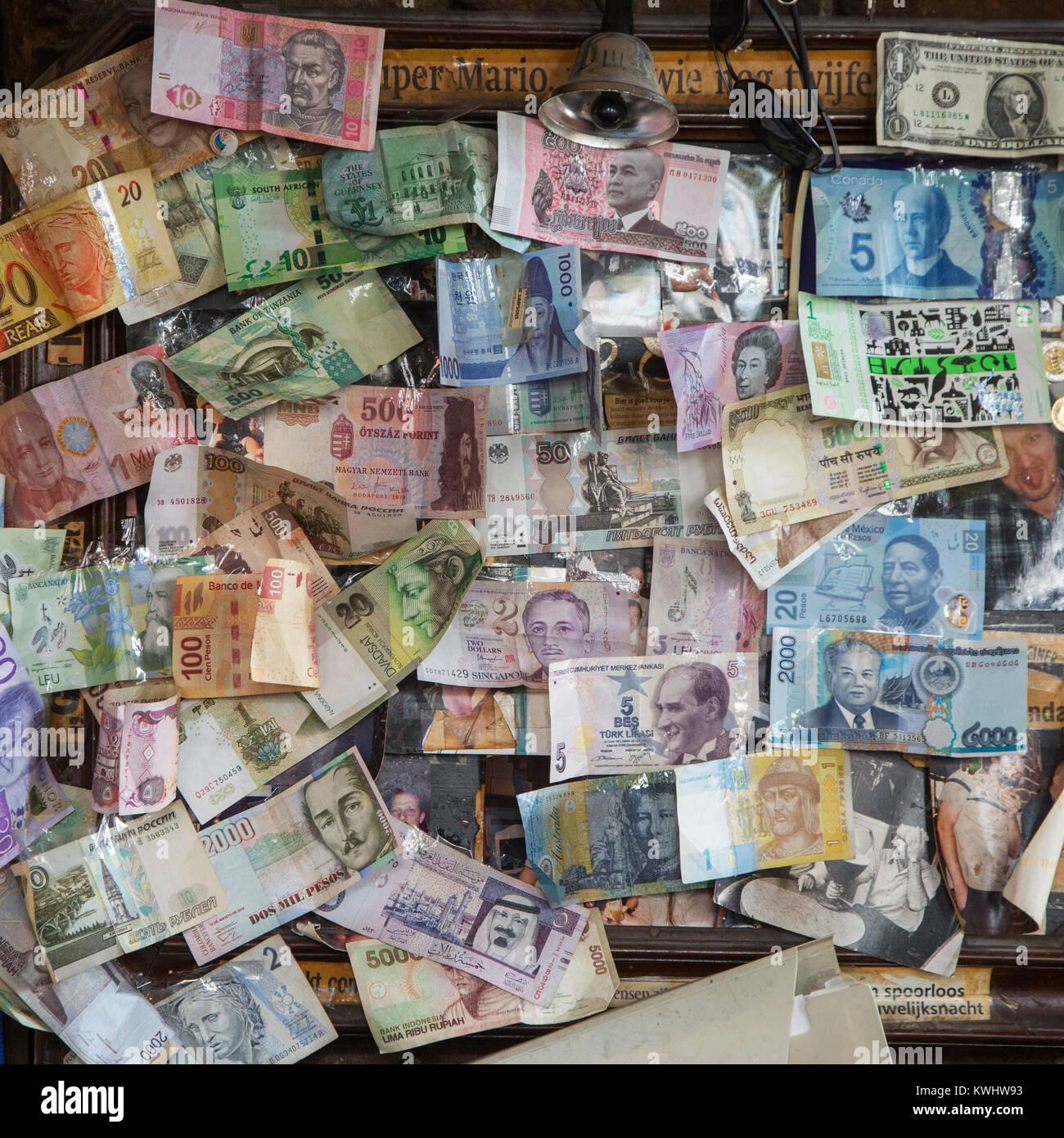 International banknotes / bank notes on the wall in Flemish café Het Waterhuis aan de Bierkant in the city - Stock Image