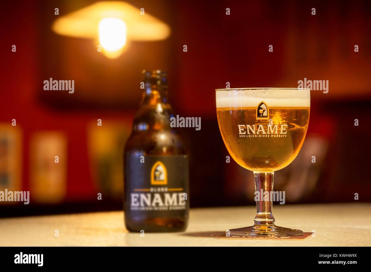 Ename blond beer glass and beer bottle, one of many Belgian abbey beers brewed in Oudenaarde, East Flanders by brewery - Stock Image