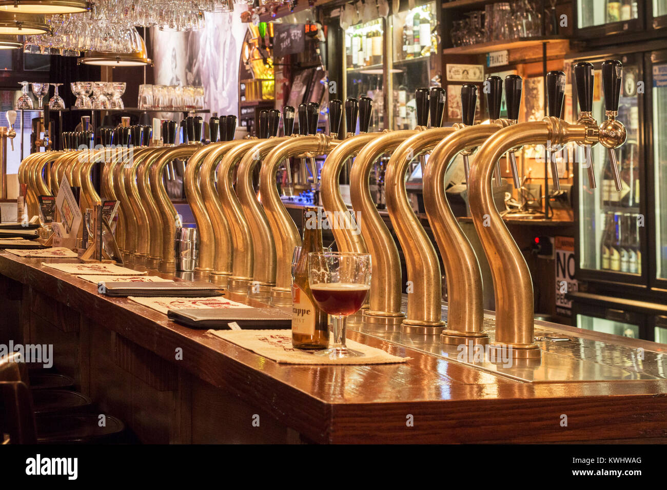 Bar counter showing array of Belgian draught beers served by taps in the Flemish café Rock Circus in the city - Stock Image