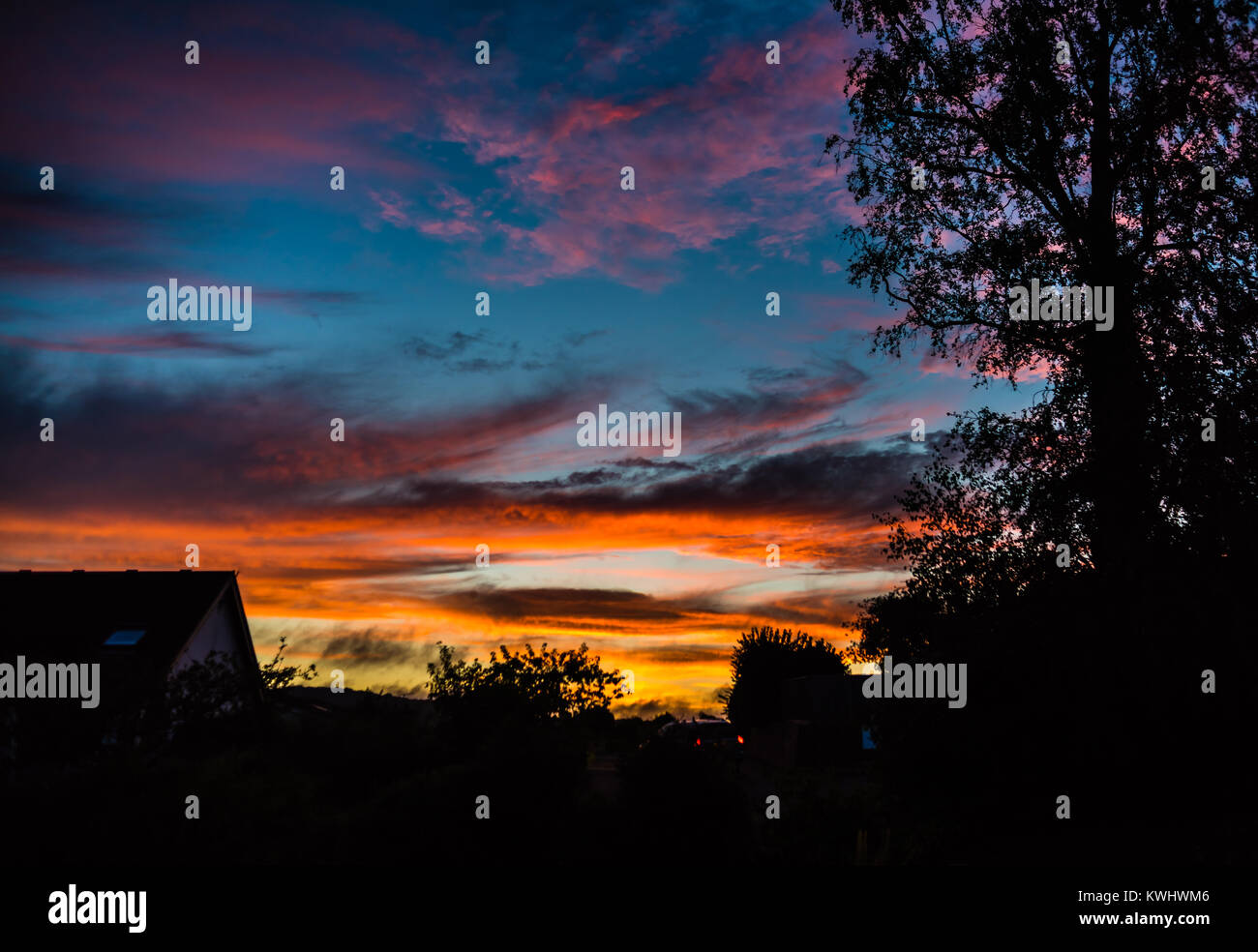 The setting sun over East Budleigh. Stock Photo