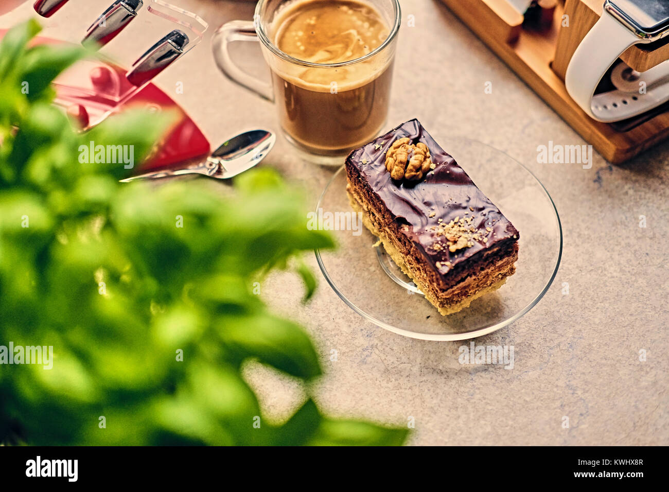 Sweet, delicious cake, herbs and cup of coffee - Stock Image
