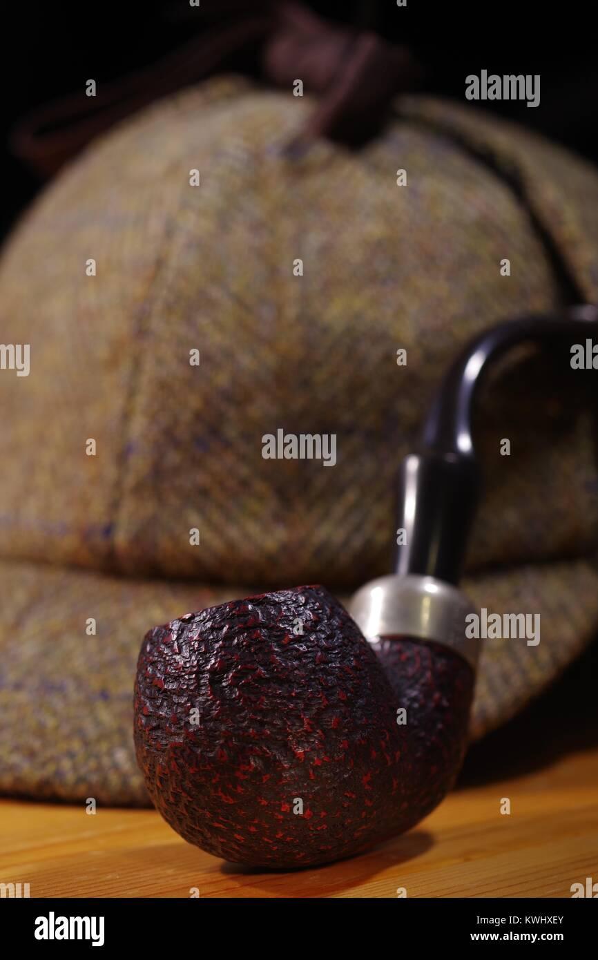 'Sherlock Holmes' Still Life Personal Effects; Deer Stalker Hat, Smoking Pipe. Exeter, Devon, UK. January, - Stock Image