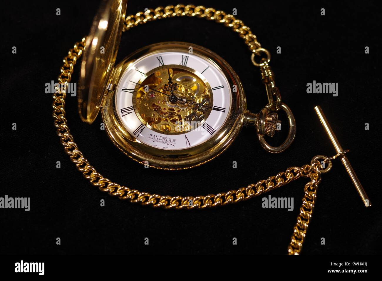 Half Hunter Gold Plated Pocket Watch Timepiece by Jean Pierre, on Black Velvet. Macro, Exeter, Devon, UK. January, - Stock Image