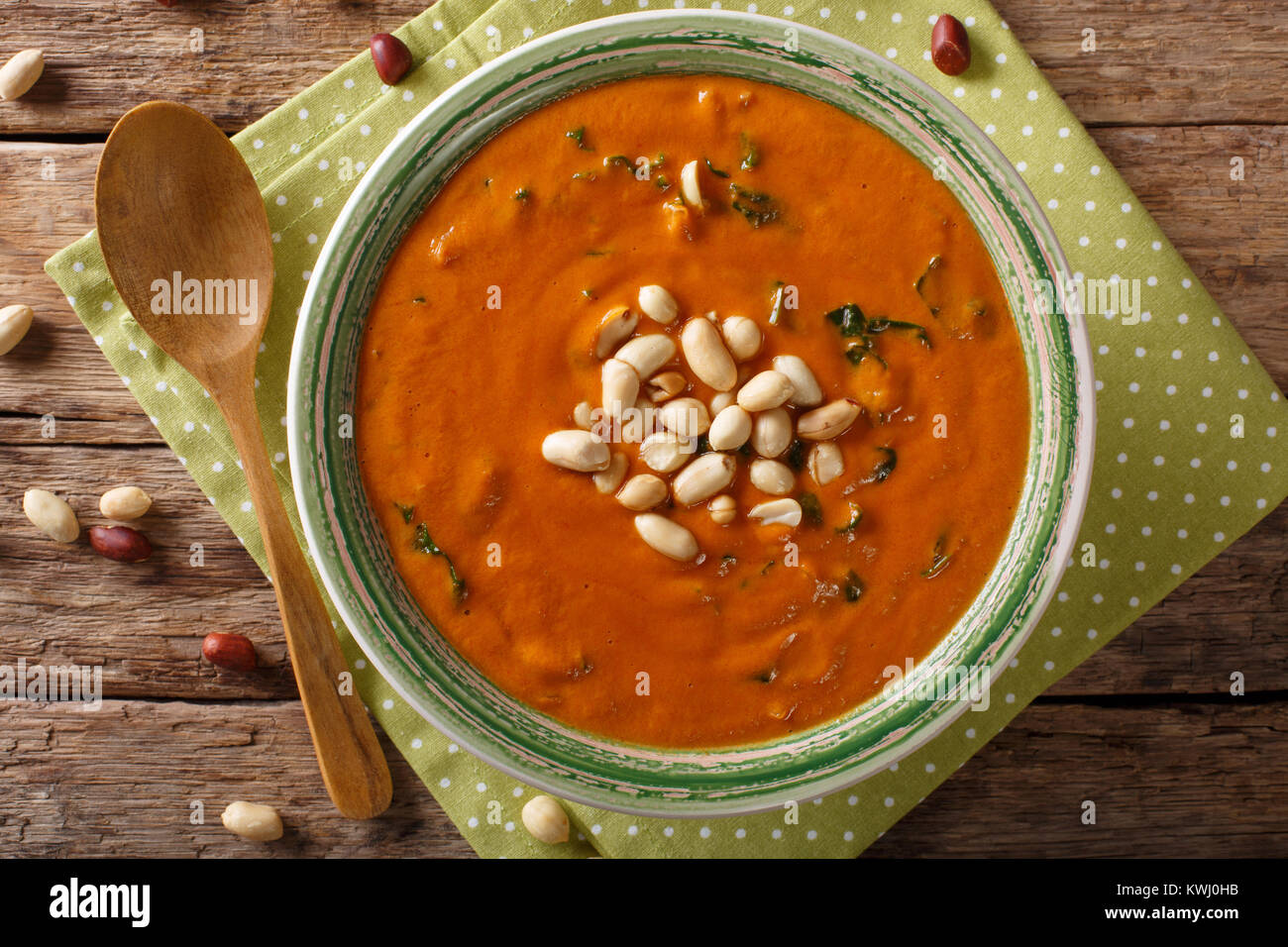 Vegetarian West African Peanut Soup close-up in a plate. on the table. horizontal top view from above - Stock Image