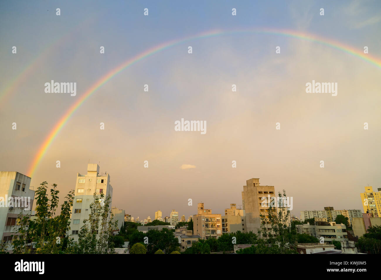 Rainbows over the city of La Plata, Argentina - Stock Image