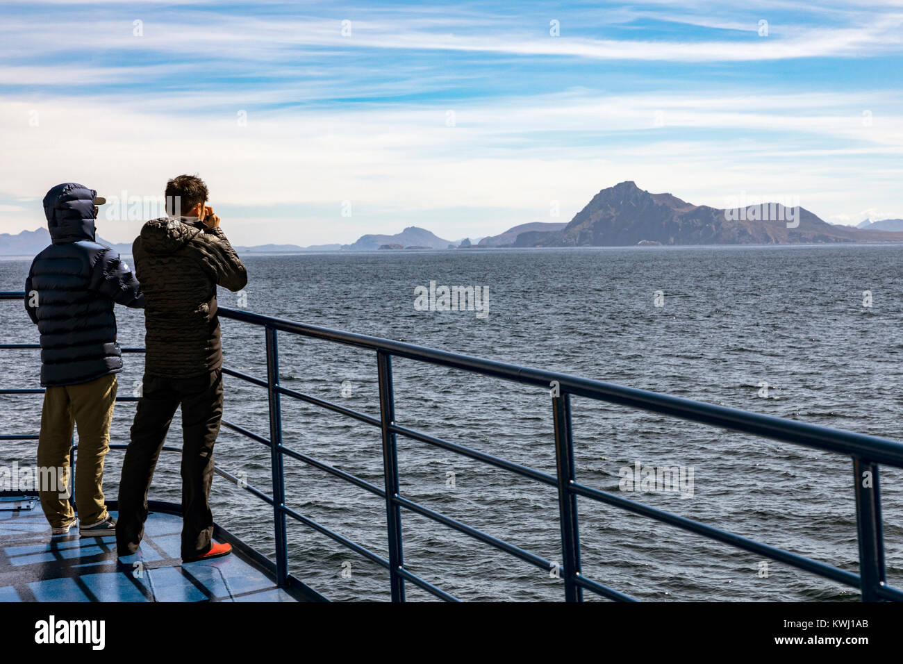 Travelers view Cape Horn; Cabo de Hornos; southernmost headland of Tierra del Fuego archipelago of southern Chile; - Stock Image