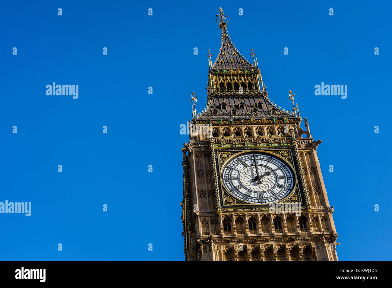 The Queen Elizabeth Tower at the Houses of Parliament, the Palace of Westminster in London against a clear blue - Stock Image