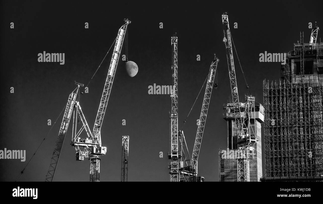 The moon hanging from a building crane hook on a Southbank building site - Stock Image
