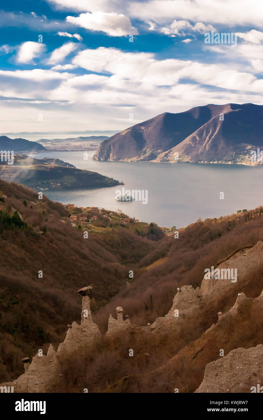 Fantastic view of Iseo Lake and the pyramids of Zone. These pyramids are particular geological formations caused - Stock Image