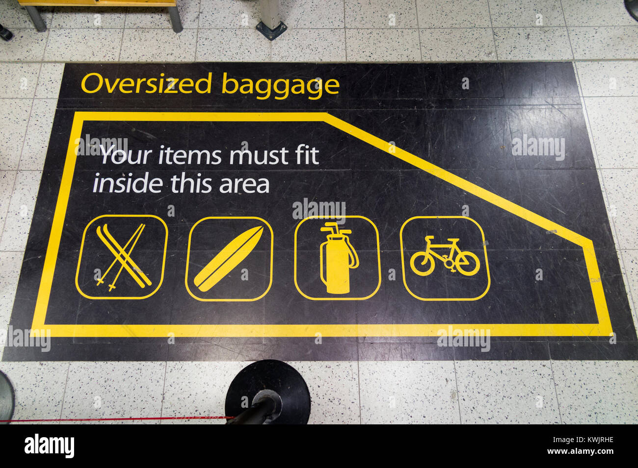 Size guide at oversized baggage drop off area zone at London Gatwick airport, for items of passenger luggage which - Stock Image