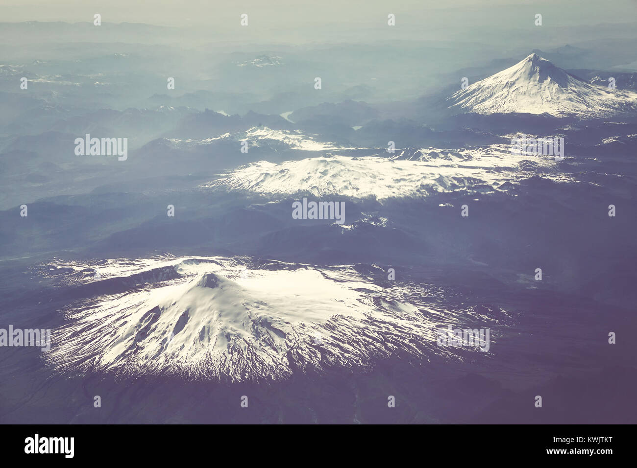 Retro stylized aerial picture of the Andes mountain range, Chile. - Stock Image
