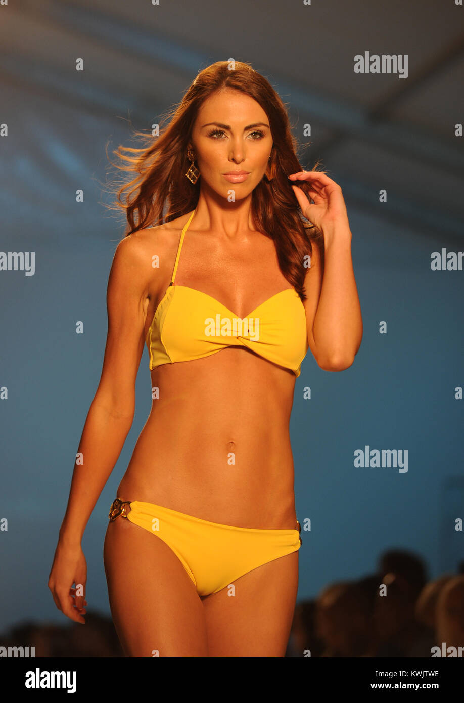 MIAMI BEACH, FL - JULY 16: A model walks the runway for the Caffe Swimwear show during Mercedes-Benz Fashion Week - Stock Image