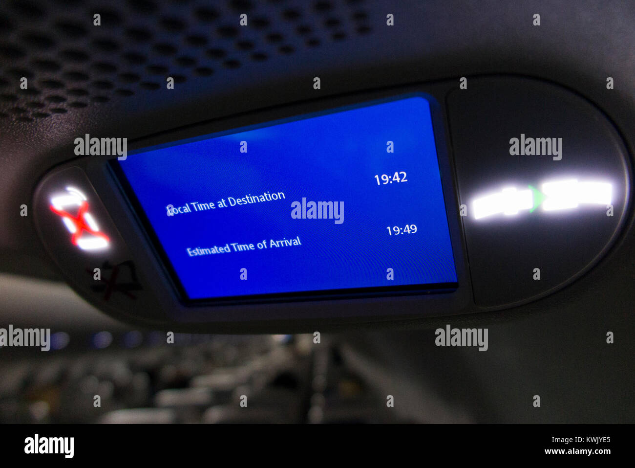 Aeroplane aircraft airplane air plane flight monitor showing travel time & distance & local time at destination Stock Photo