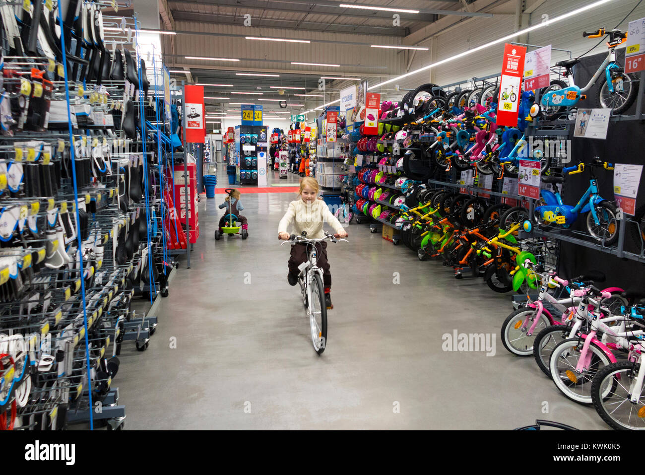 0c3ace1eae Children ride new bikes on sale in Decathlon store   shop   sports equipment  retailer in France   French superstore at Grésy-sur-Aix. France. (93)