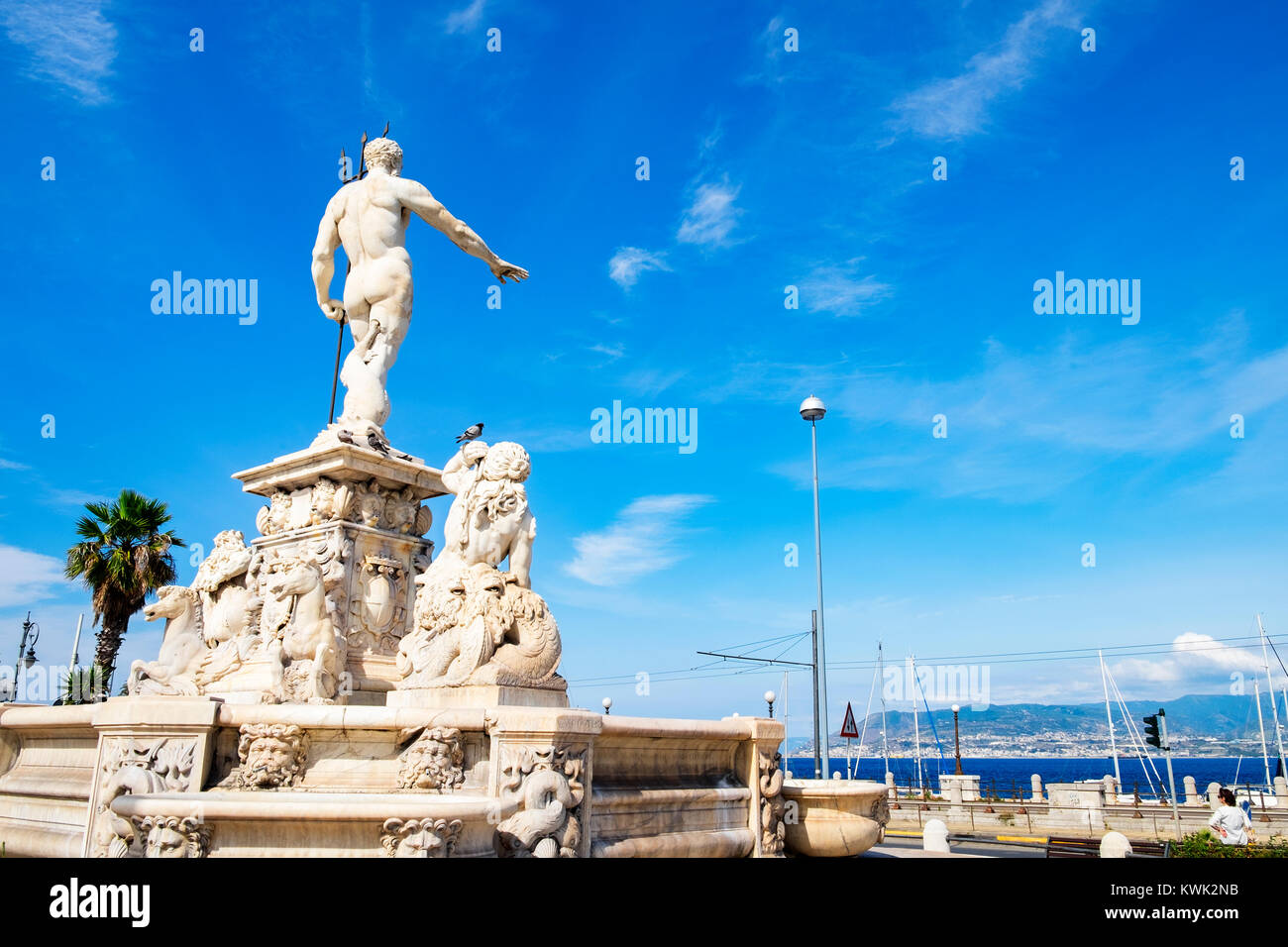 sculpture of neptune overlooking the harbor at messina on the island of sicily, italy. - Stock Image