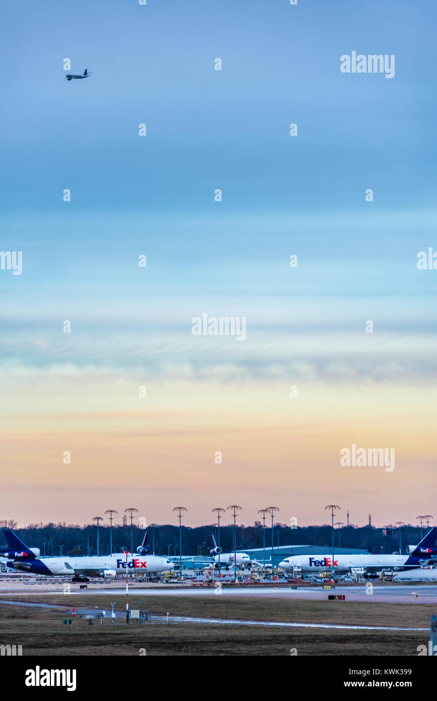 FedEx Express jets at Memphis International Airport, FedEx's world hub, under a colorful sunset sky in Memphis, - Stock Image