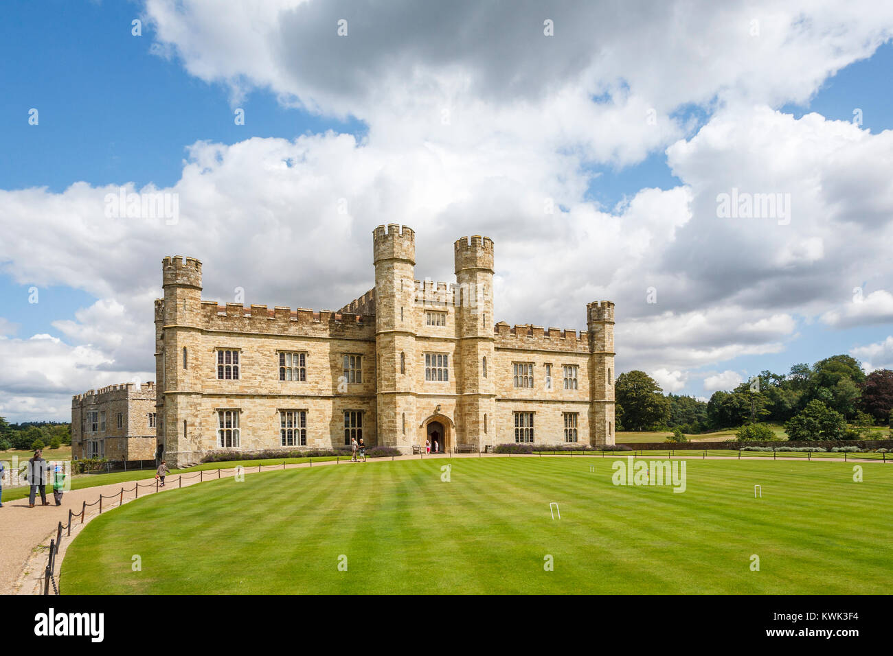 Main entrance facade to Leeds Castle, near Maidstone, Kent, southeast England, UK and croquet lawn on a sunny day - Stock Image