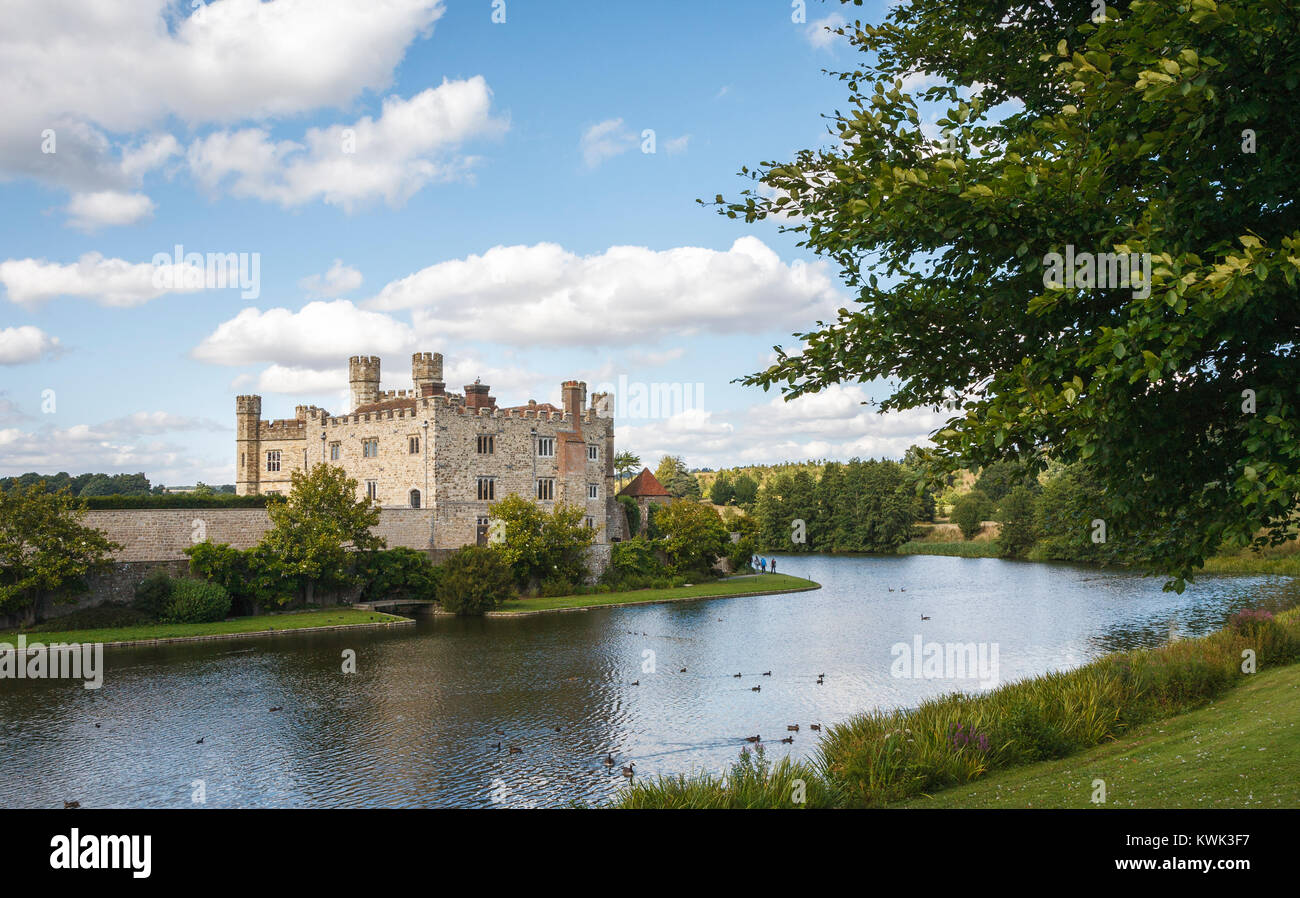 View of the exterior of Leeds Castle and its moat, near Maidstone, Kent, southeast England, UK on a sunny day with - Stock Image