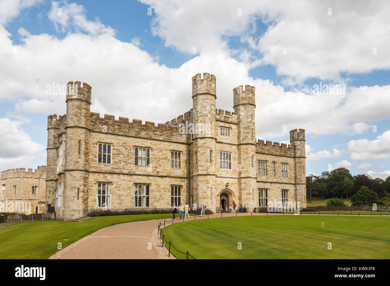 Main entrance facade to Leeds Castle, near Maidstone, Kent, southeast England, UK and croquet lawn with towers and - Stock Image