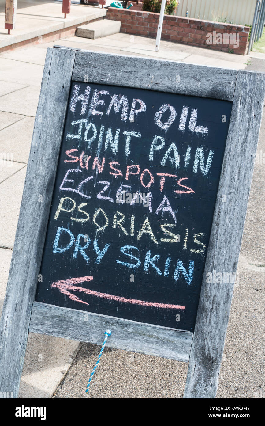 Chalk board advertising shop selling Hemp Oil for various ailments. , Nundle NSW Australia. - Stock Image