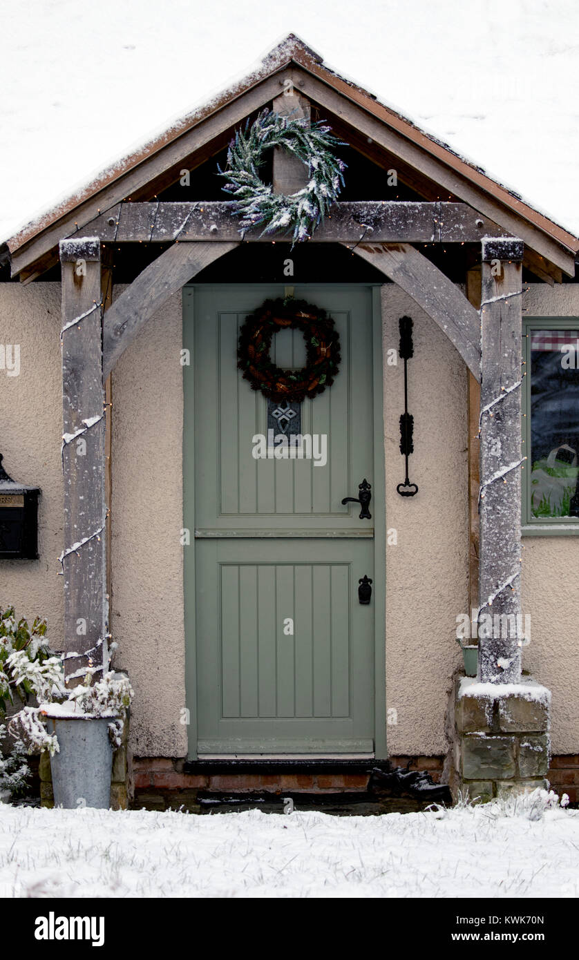 Front stable door with christmas wreath on the door and on oak porch on