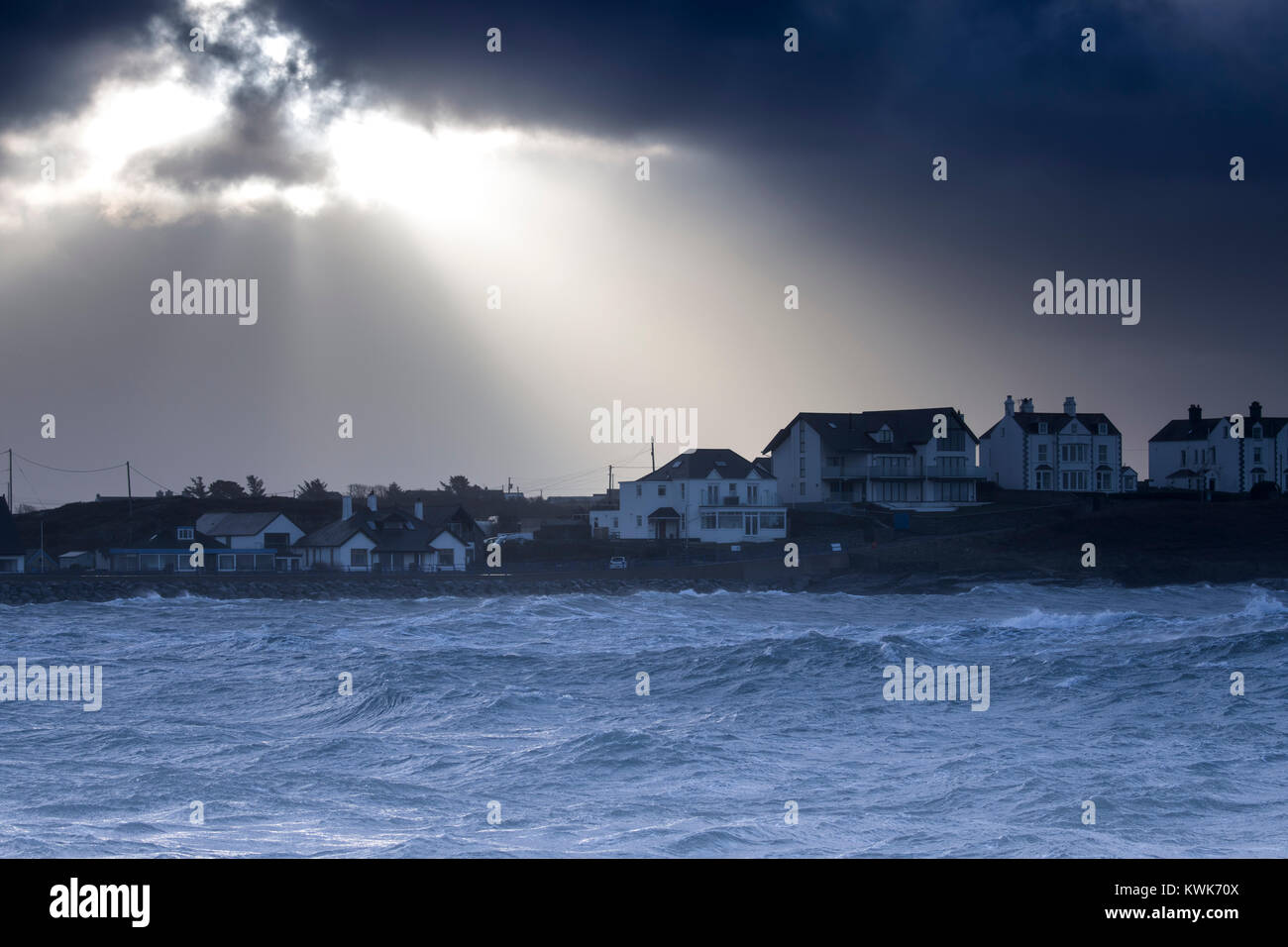 Coastal flooding and huge waves crash into the small isolated Trearddur Bay on the Isle of Anglesey during storm - Stock Image