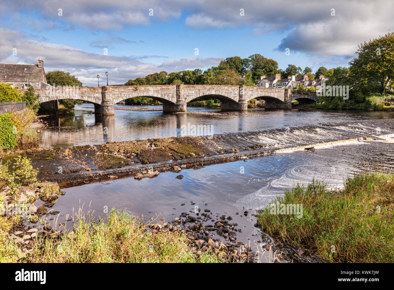 Bridge and weir on the River Cree at Newton Stuart, in The Machars region, Dumfries and Galloway, Scotland. - Stock Image