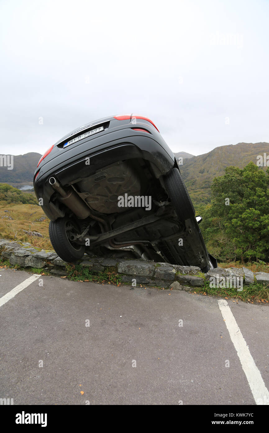 Car Freewheeled From Parking Spot And Rolled Over The Mountain At Stock Photo Alamy