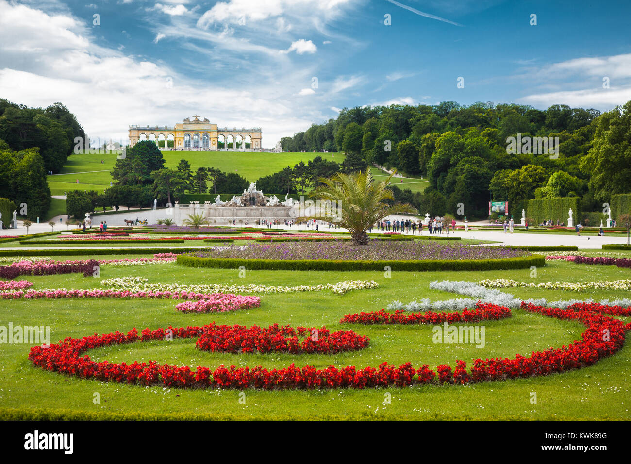 Classic view of scenic Great Parterre garden with Gloriette on a hill at famous Schonbrunn Palace on a beautiful - Stock Image