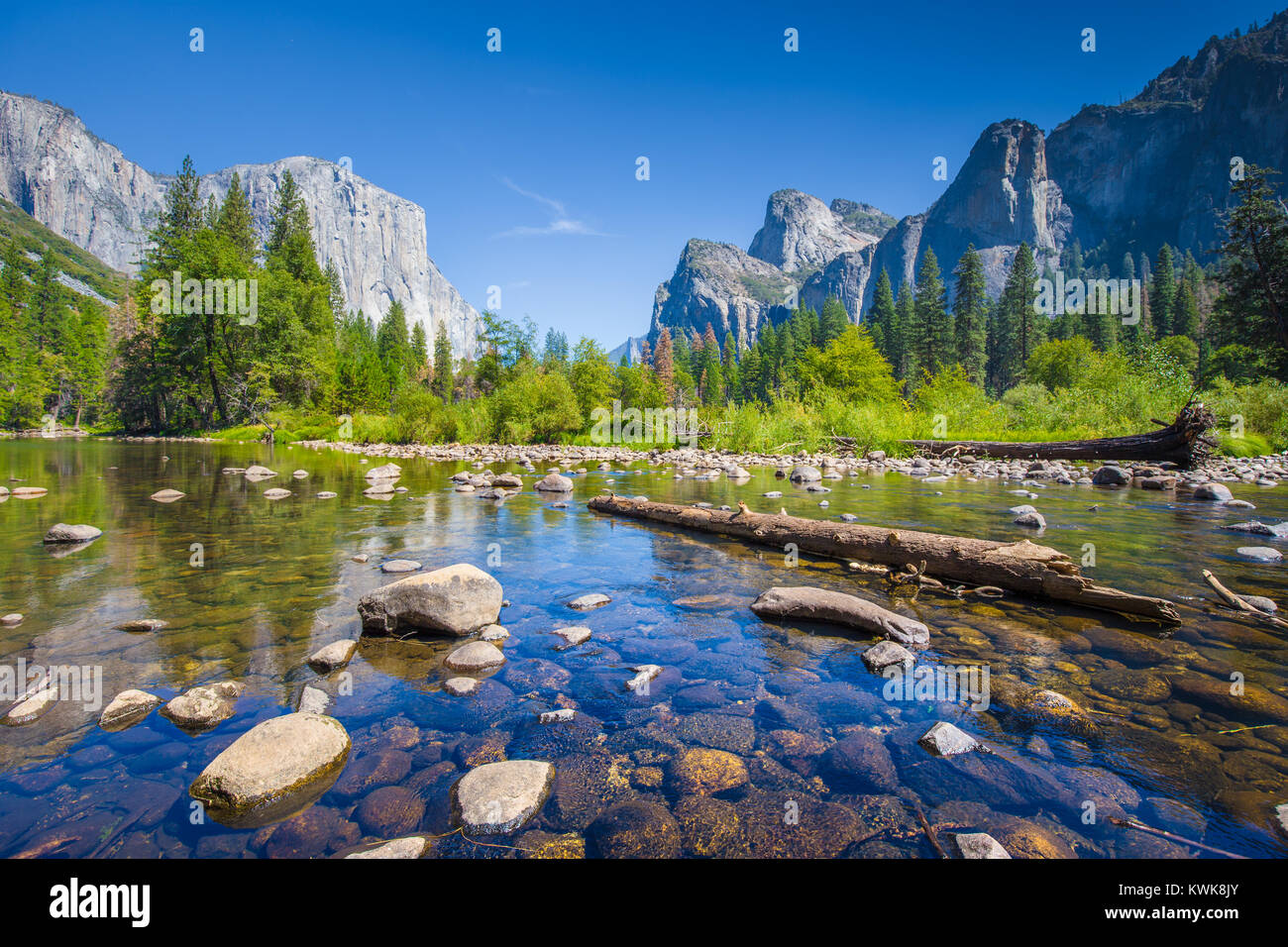 Classic view of scenic Yosemite Valley with famous El Capitan rock climbing summit and idyllic Merced river on a Stock Photo