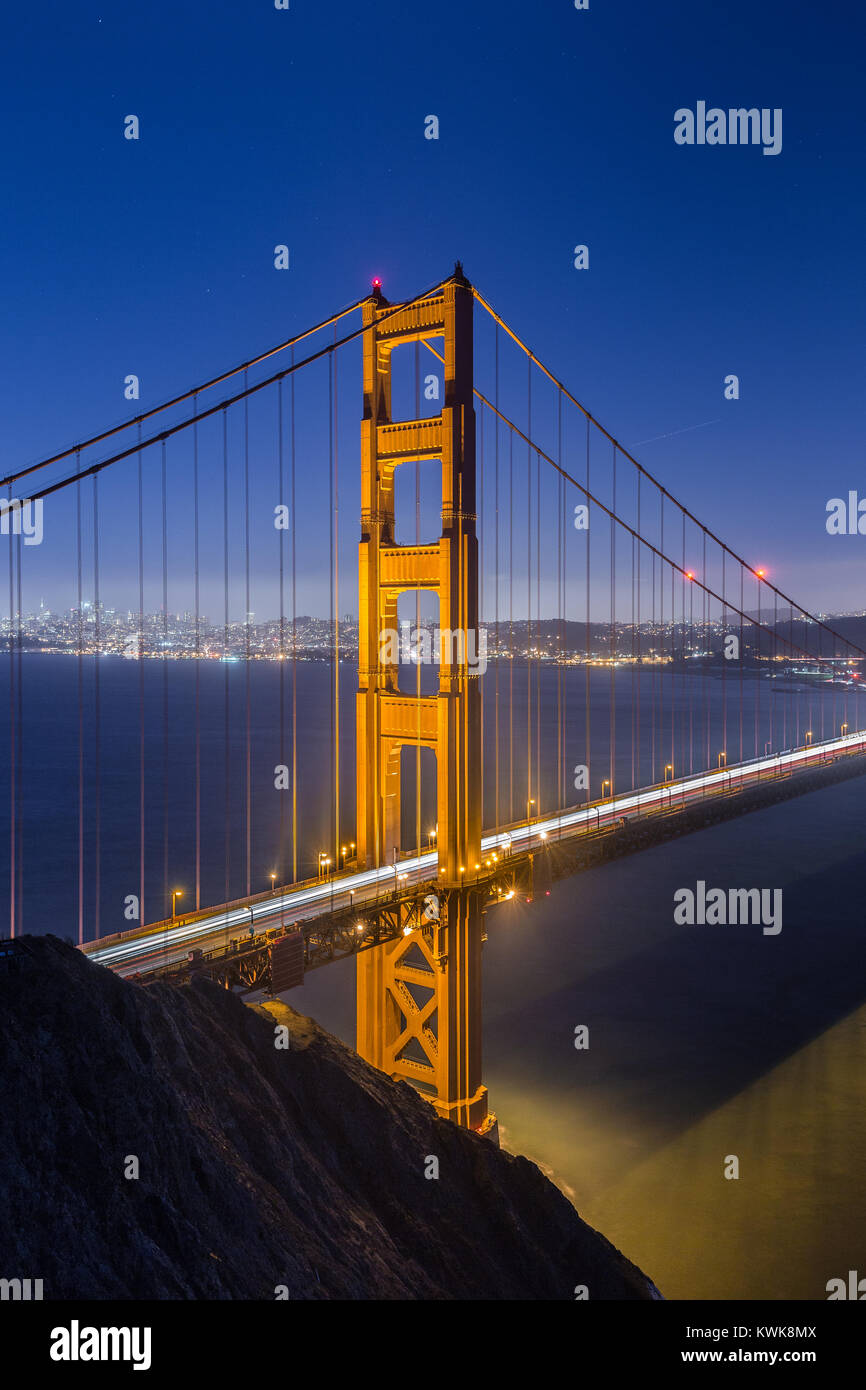 Classic vertical view of famous Golden Gate Bridge seen from Battery Spencer viewpoint in beautiful post sunset - Stock Image