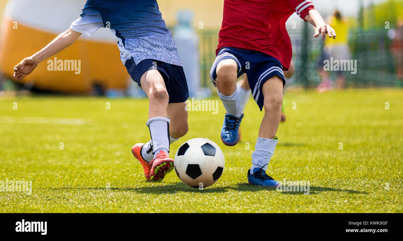 Young Soccer Players Competition. Boys Kicking Football Ball. Soccer Youth Teams Play Outdoor Tournament. Soccer - Stock Image