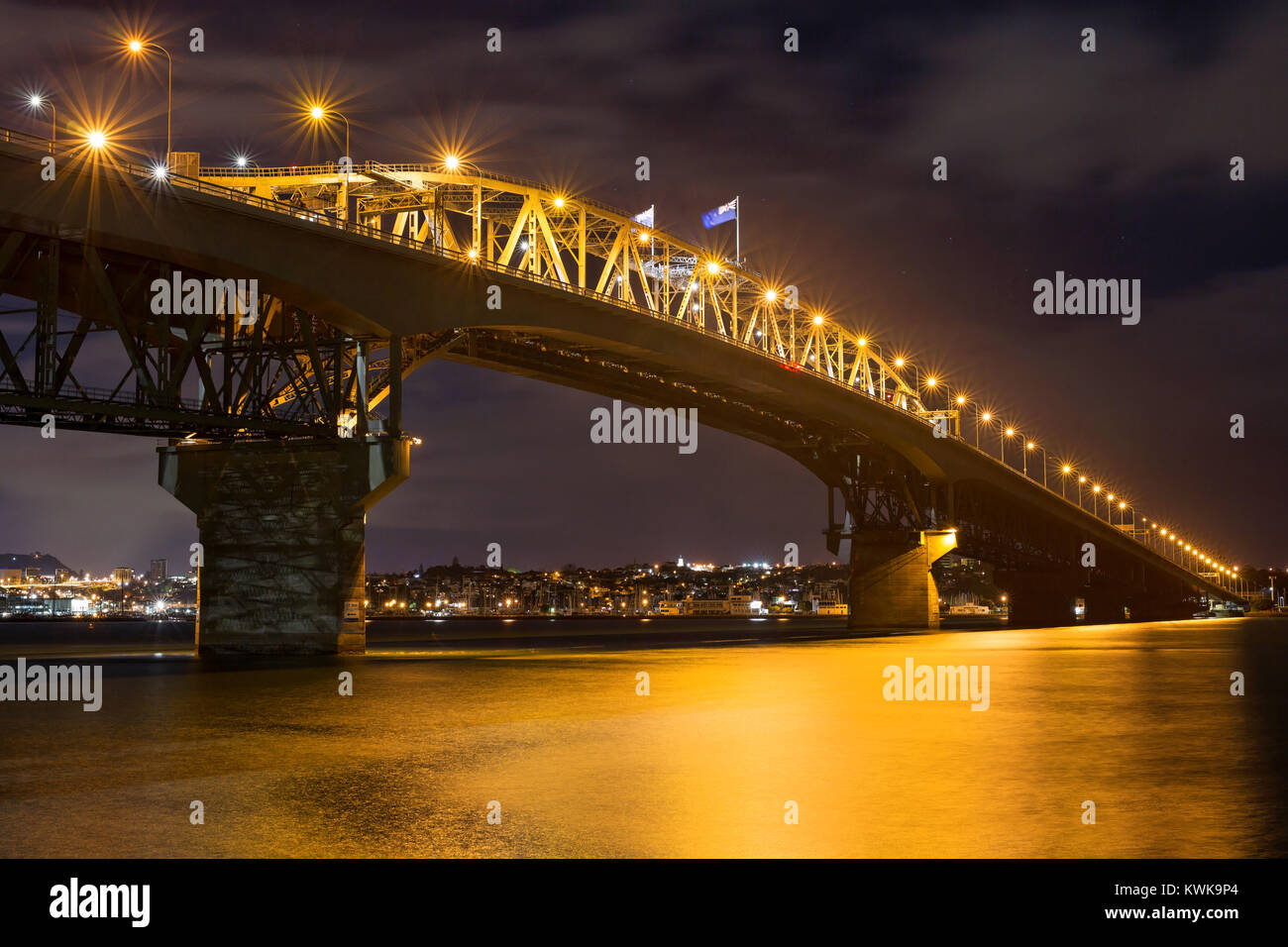 Auckland Harbour Bridge by night, New Zealand - Stock Image